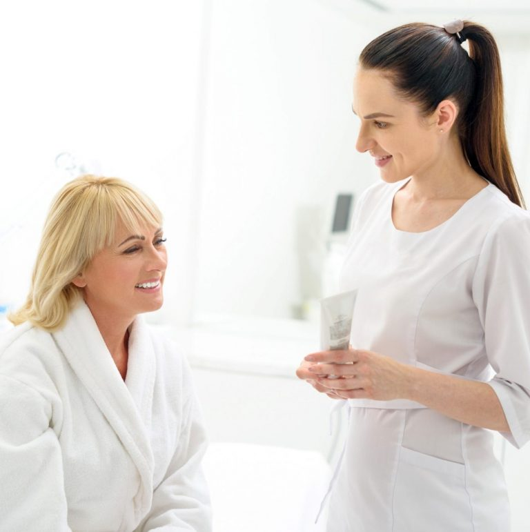 Woman consulting with a skincare specialist.