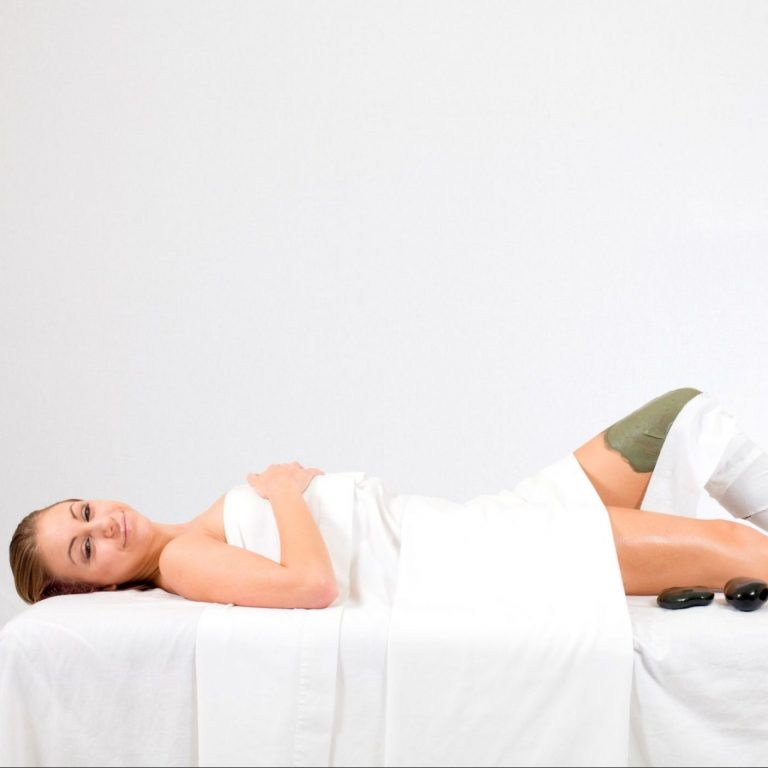 Woman relaxing with a body wrap layered over her leg.